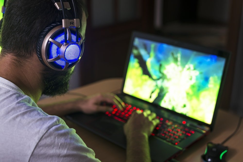 Man playing on gaming laptop