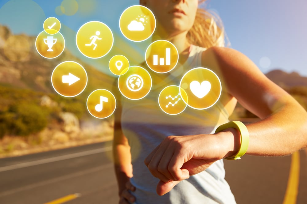 woman using fitness tracker apps