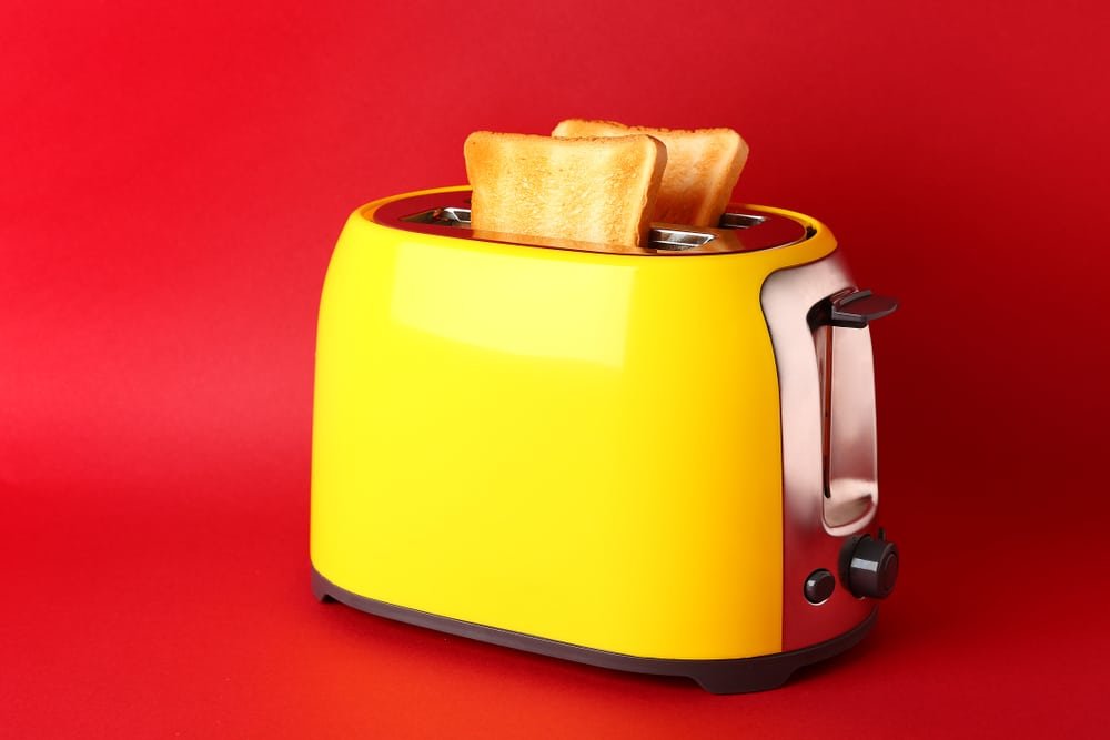 yellow toaster with toast