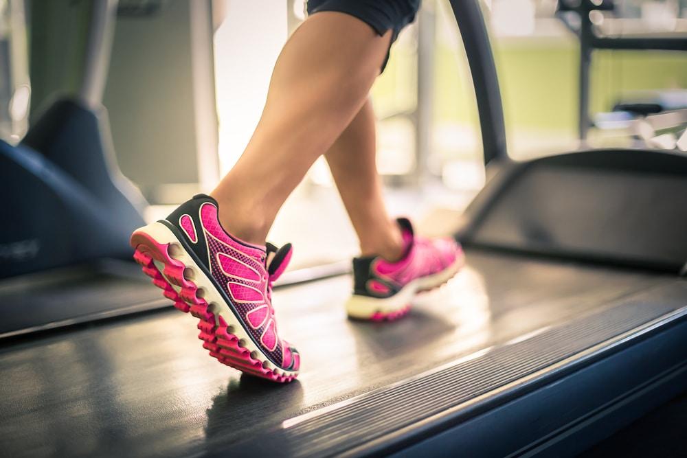 fitness woman runs on treadmill