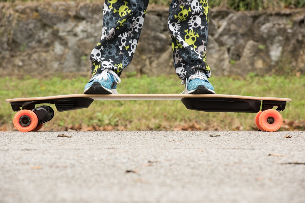 child riding an electric skateboard
