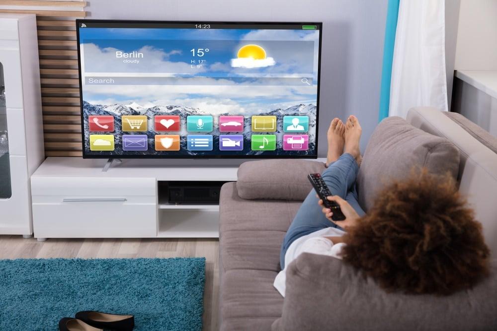 woman on sofa watching TV