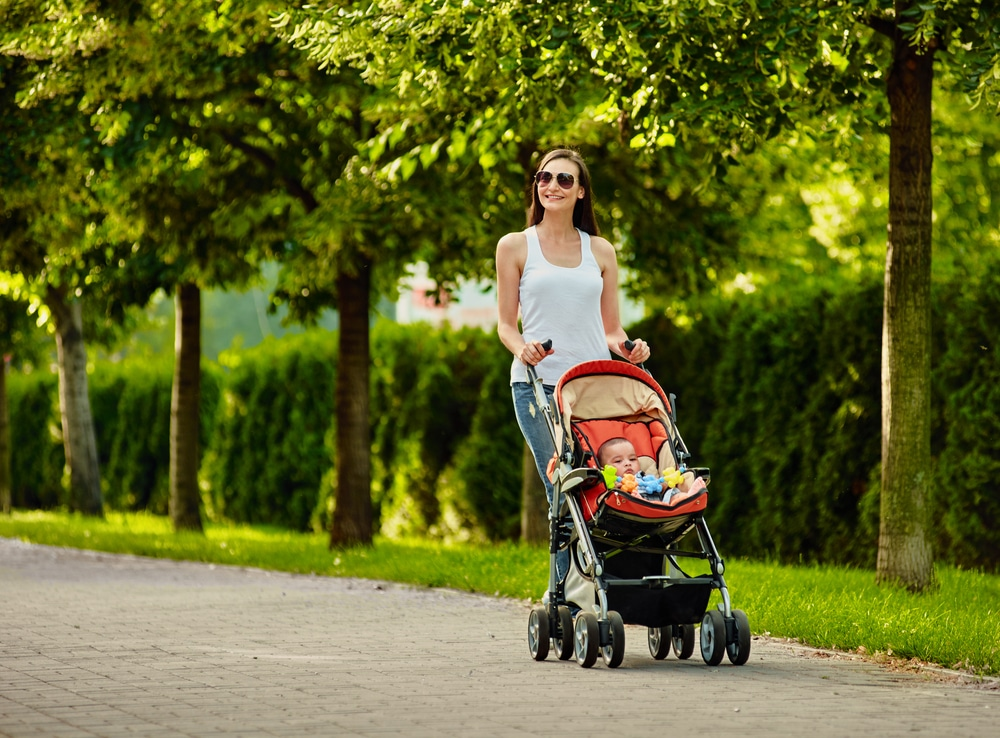 woman pushes baby in stroller